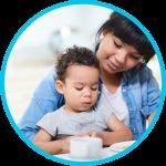 Daycare provider feeding baby