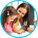 Daycare provider and child coloring and having fun together